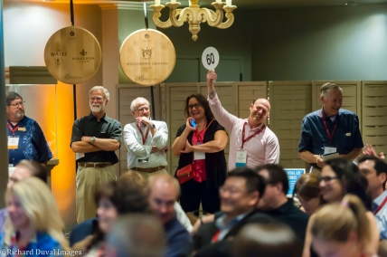 USA, Washington, Woodinville. Private Barrel Auction at the Auction of Washington Wines.